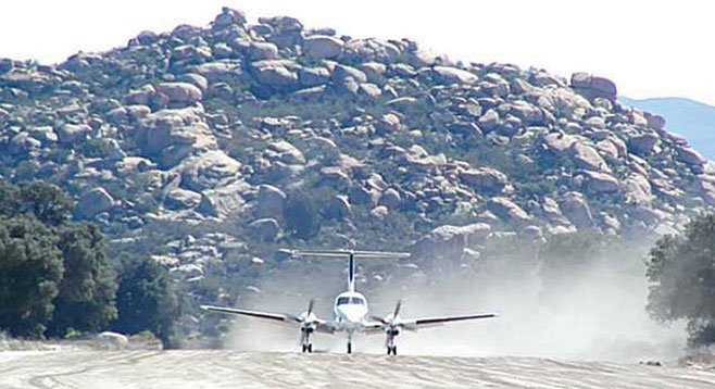How many properties come with their own mile-long runway?