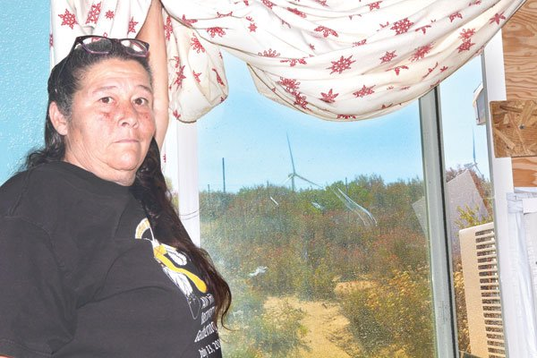 Annoyance with the rotating shadows of distant wind turbine blades prompted Ginger Thompson to cover her windows.