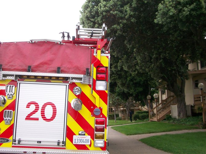 San Diego Fire truck responds to emergency at Pt. Loma Beach & Tennis Club apartments.