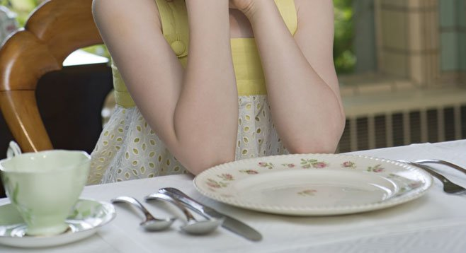 Elbows are okay on the table, as long as there's no food at one's place.
