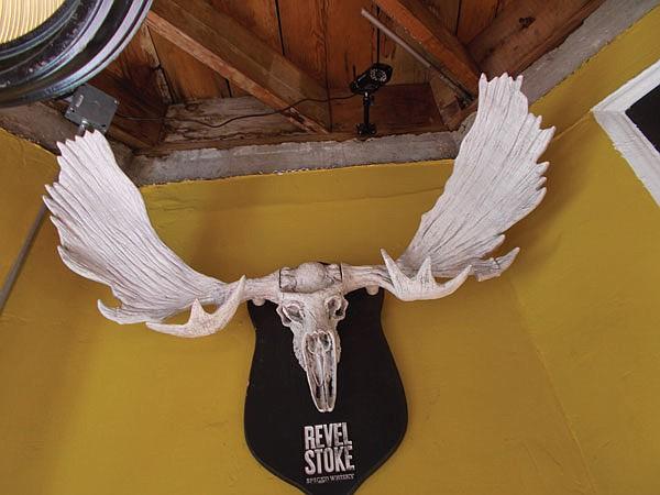 Moose horns hang above the corner entrance