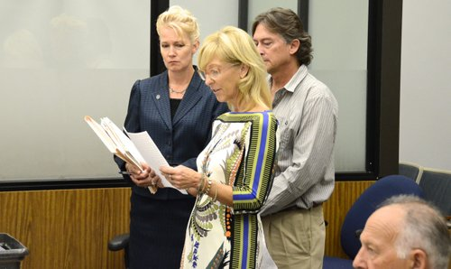 Prosecutor Anna Winn with the owners of the pizza shops. Photo Weatherston.