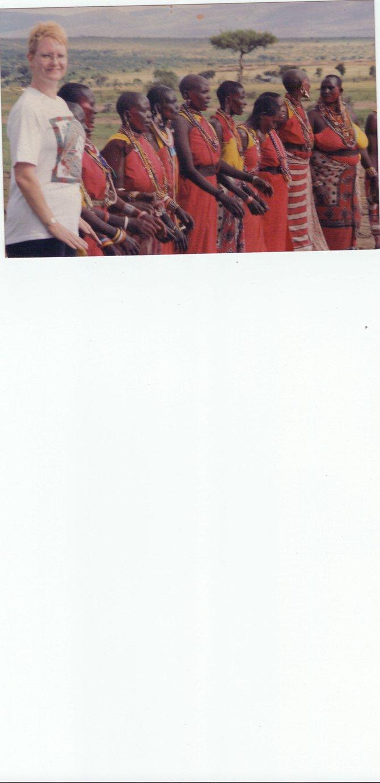 Masaai Tribe women ask me to join them in a ritual dance.
