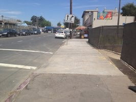 Current drive-through exit will knock pedestrians out of the crosswalk!
