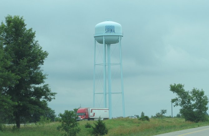 What's up with all the tall water towers in every town?