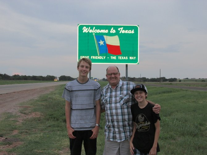 The author, embarassing his sons Johnny & Trevor, to all the passing truckers.