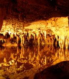 "In the heart of the Luray Caverns, ""Dream Lake"" behaves like a reflecting pool, despite ..."