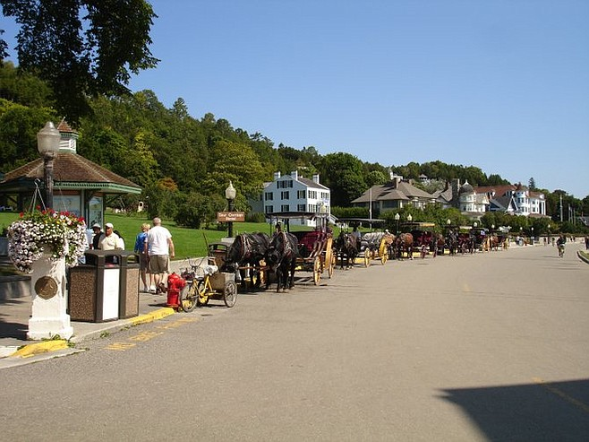 Horse-drawn carriages line up to take visitors to their accommodations.