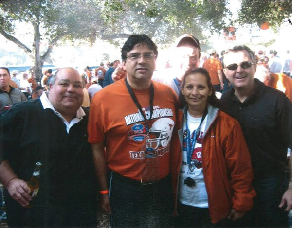 Gary Cabello and Jesus Gandara, former superintendent of Sweetwater Union High School, pose with football fans.