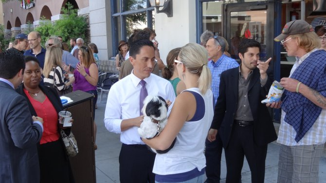 Todd Gloria working the crowd after the parklet's ribbon-cutting ceremony.