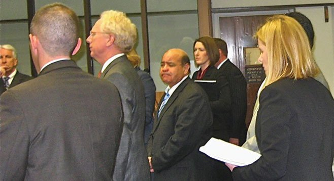 Bond underwriter Gary Cabello's sad face might be due to being indicted by the grand jury.