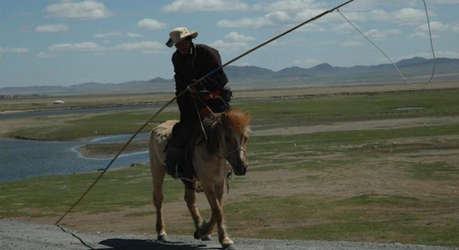 Horseman, Mongolia. Typical sight on the Trans-Mongolian train.