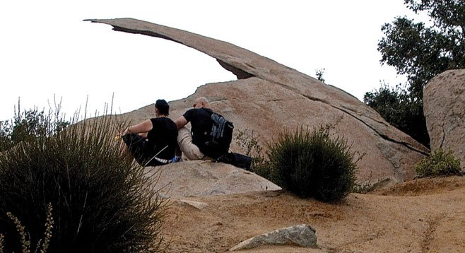 Hikers take a break at Potato Chip Rock.