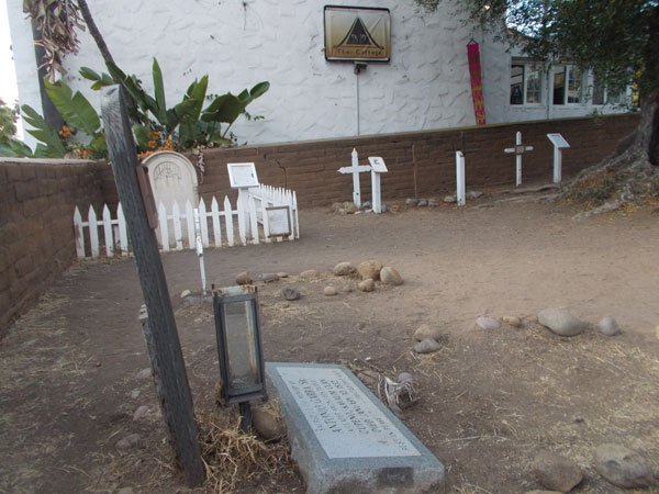 Campo Santo, Antonio Garra's grave, with D'O Thai Cottage in background