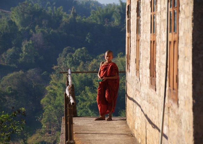 Novice monk on the the monastery's balcony. Inle Lake, Myanmar (Burma).