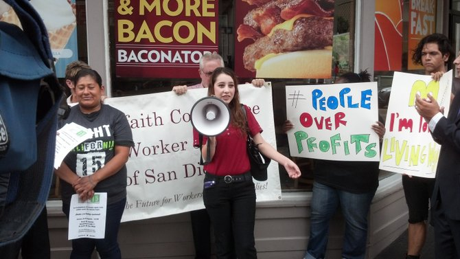 Debra Flores, a Wendy's employee participating in the one-day strike, addresses the crowd