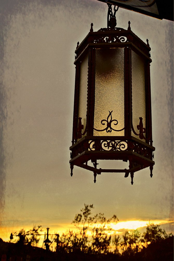 vintage lantern at Greaseland Flat near Pinnacle Peak, against the backdrop of an Arizona sunset