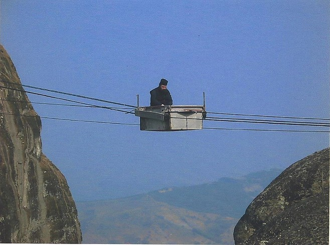 Monk in cable car, Meteoras.