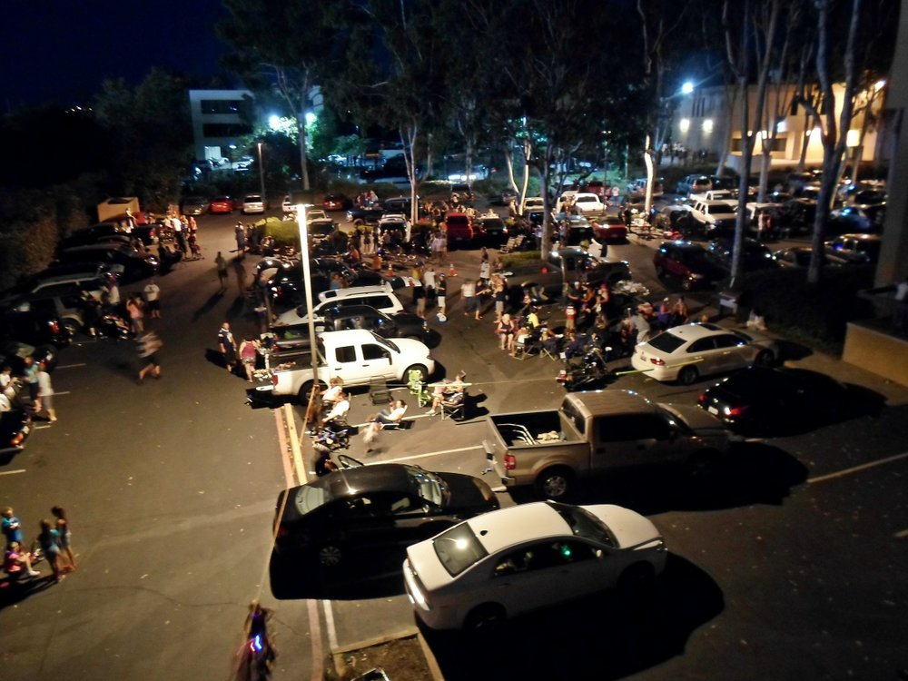 Waiting for the show to begin — the crowded parking lot as seen from the roof.