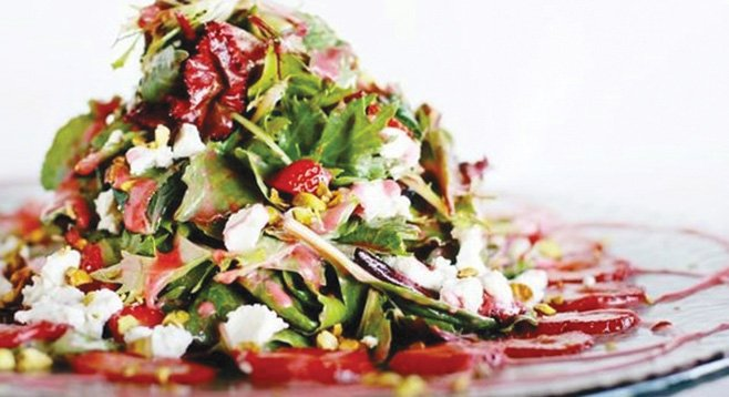 Cafe 21's strawberry salad (pistachios and goat cheese tossed with crisp greens and a light raspberry vinaigrette) delighted Mary Beth Abate.