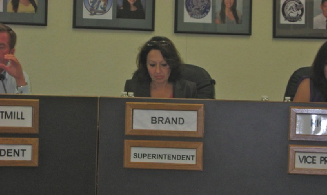 Sweetwater's Maria Castilleja at a board meeting, filling in for superintendent Ed Brand on July 15, 2013