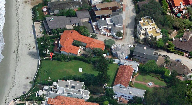 The red-roofed Romney home at 311 Dunemere Drive (center). Image from Google Maps.
