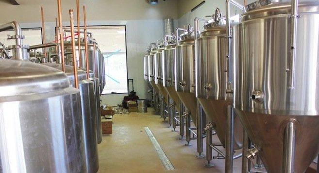 Ballast Point Little Italy's brewing equipment during the installation process.