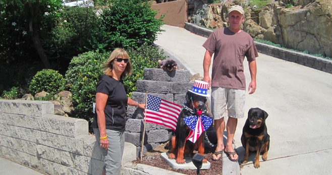 Janet Mika, Rick Albin, and Gracie the rottweiler with Madra Dog