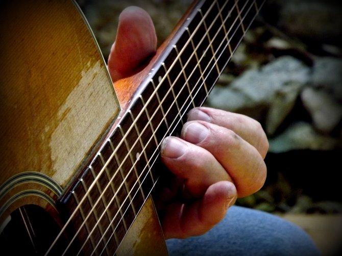 Friend playing guitar. San Diego