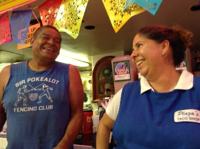 Mayra with regular customer Neldo