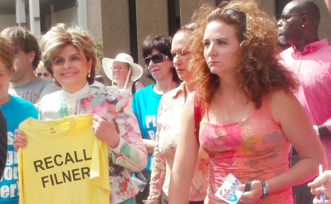 Katherine Ragazzino (in tank top); Gloria Allred (left)
