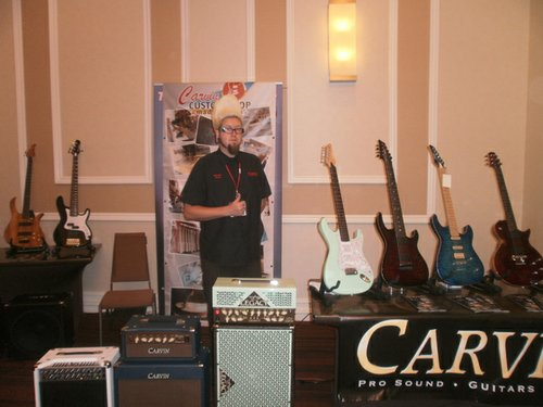 Carvin Guitars Flock (of Jason Lee & The Riptides) at the trade show. Photo by Bart Mendoza.