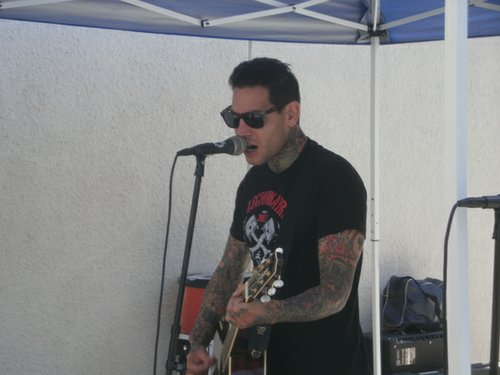 MXPX frontman Mike Herrera was in acoustic mode for his pool side set. Photo by Bart Mendoza.
