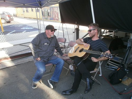 Michael Halloran of 91X holding court backstage at the Ohio St. block party. Photo by Bart Mendoza.