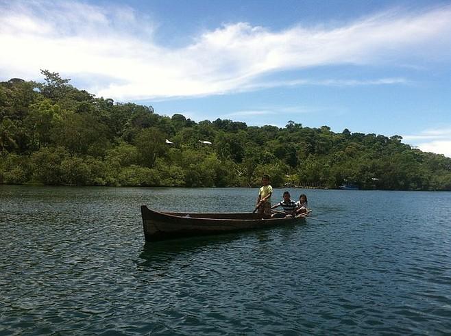 Children paddling by.