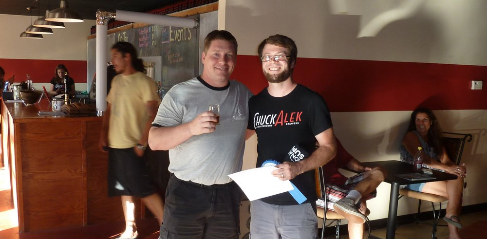Winning homebrewer Travis Hammond (left) and ChuckAlek owner and brewer Grant Fraley