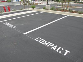 "A newly remodeled parking lot in Carlsbad, which still allows developers to use the ridiculous ""compact"" sized spaces."