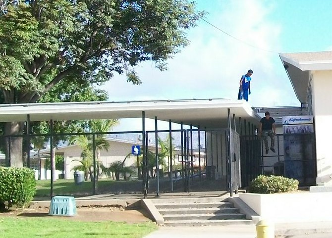Two boys were seated on the Mar Vista Middle School roof drinking bottled water.