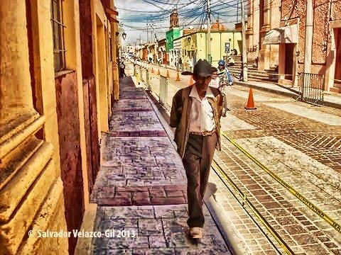 Travel Photos  MEXICO Man walking early morning in Dolores Hidalgo,Guanajuato. / Caballero caminando temprano por Dolores Hidalgo,Guanajuato.