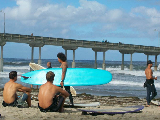 Surfers get ready to Paddle Around the Ocean Beach Pier for Clean Water.