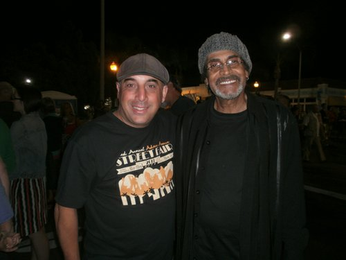 One of the Adams Avenue Street Fair bookers, Steve Kader with Love guitarist Johnny Echols. Photo by Bart Mendoza.