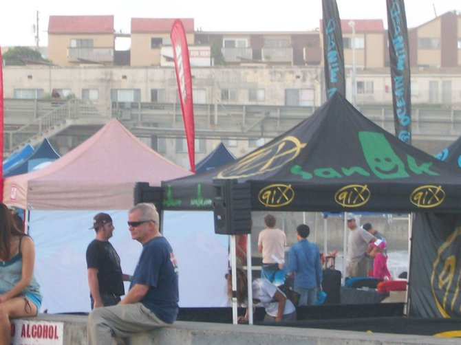 91X tent on beach at Paddle Around the Pier at the Ocean Beach Pier.