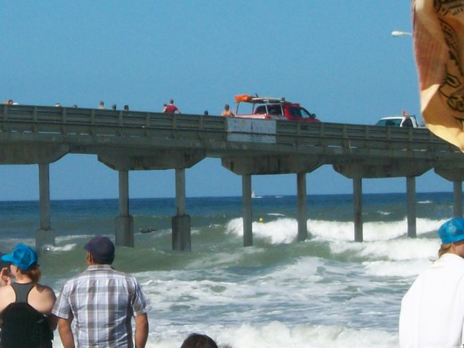 Lifeguard truck on Ocean Beach Pier watching the Paddle Around the Pier event.