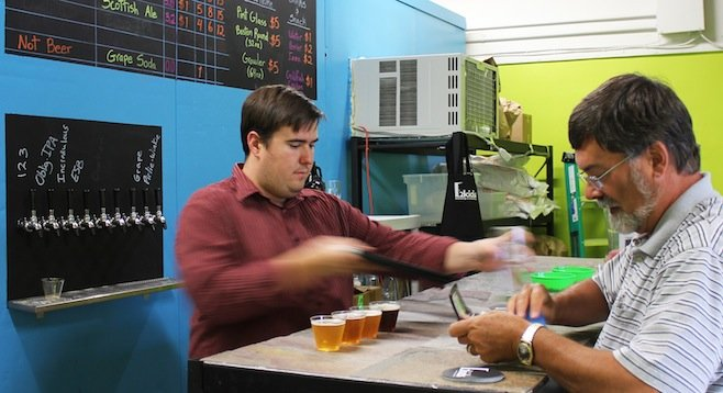 Co-owner and brewer Rob Dufau serves customers at Two Kids' tasting room.