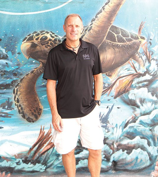 Michael Timm in front of his Sports Arena Blvd. scuba shop, Dive California.