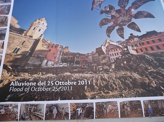 Pictures of the 2011 flood greet visitors to Vernazza.