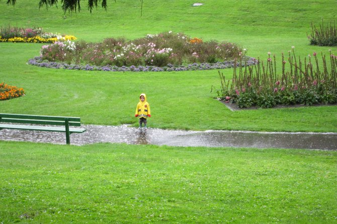 A little boy stands in a puddle during the rain at San Francisco's Golden Gate Park.