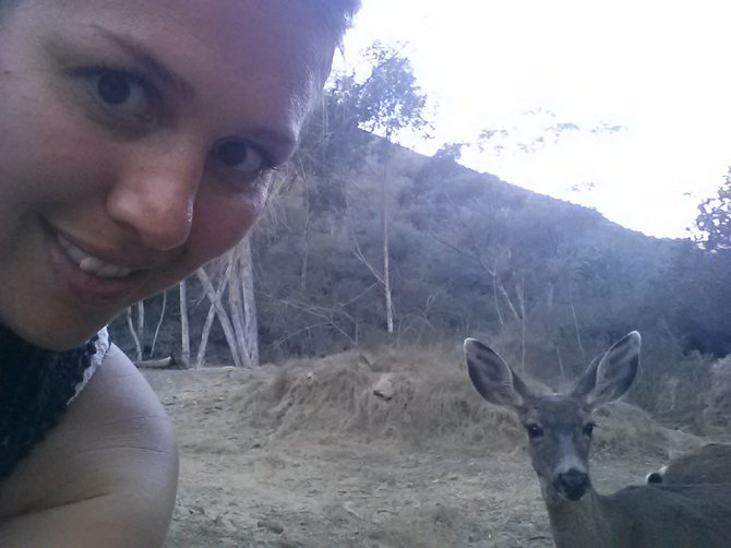 My sister meets a mommy deer on Catalina Island.