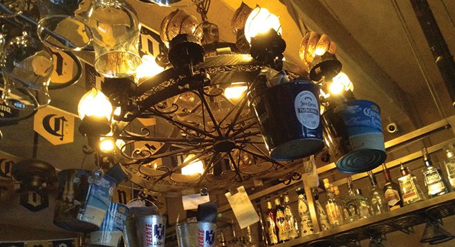 Ice buckets hang from the big wrought-iron chandelier.