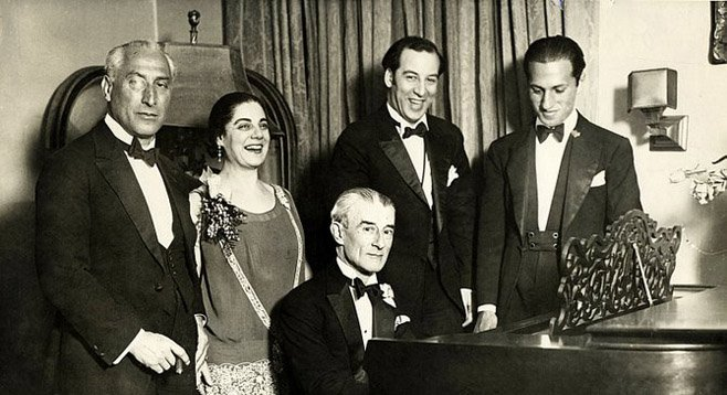 Ravel at piano with Gershwin at far right.